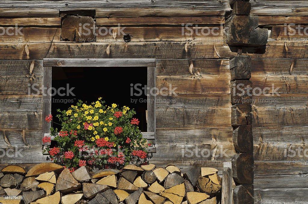 Rustic wooden barn decorated with flowers, Dienten, Hochkonig, Salzburg, Austria stock photo