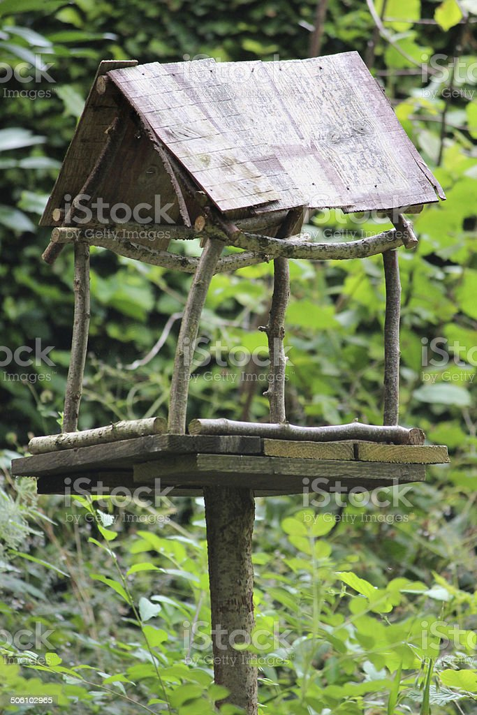 Rustic wooden bird table in garden / homemade bird table image royalty-free stock photo