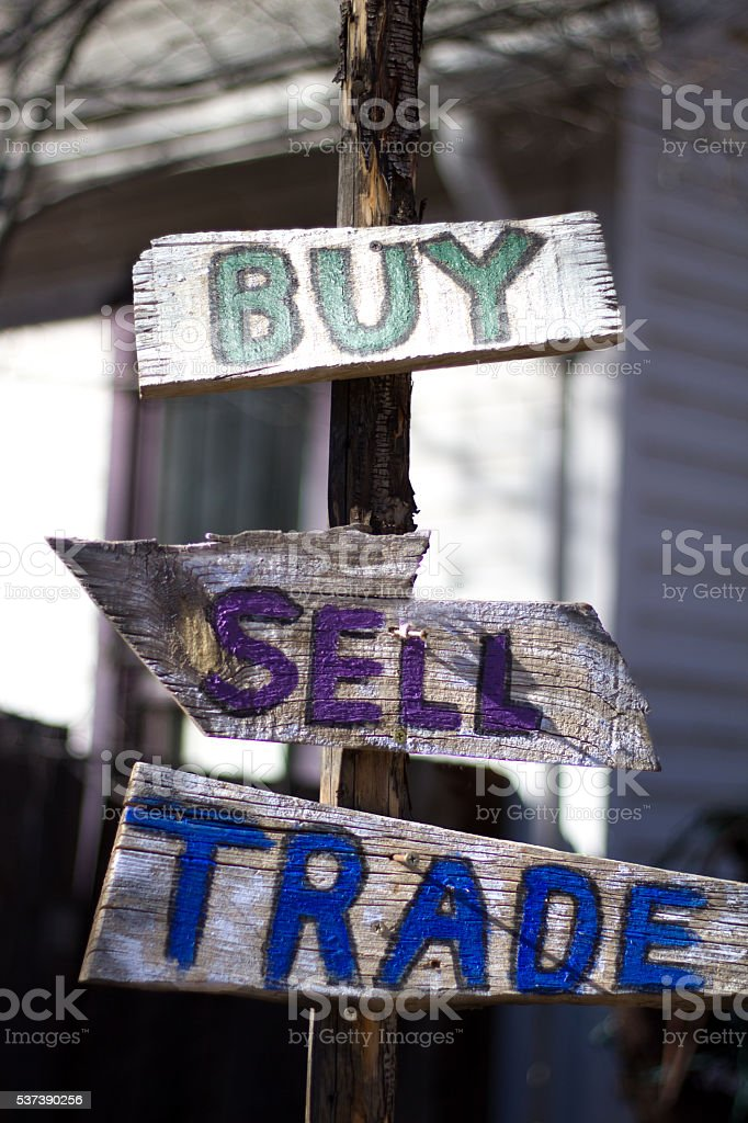 Rustic Wooden Hand-Printed 'BUY SELL TRADE' Signs stock photo