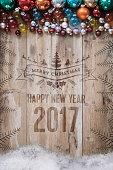 rustic wooden planks with christmas embossing and retro balls