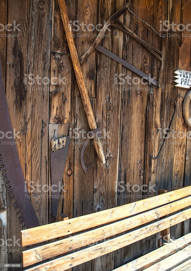 Rustic Wooden Wall With Tools And Saws stock photo