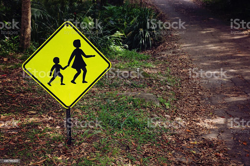 Rustic Yellow children crossing sign, vintage filter stock photo
