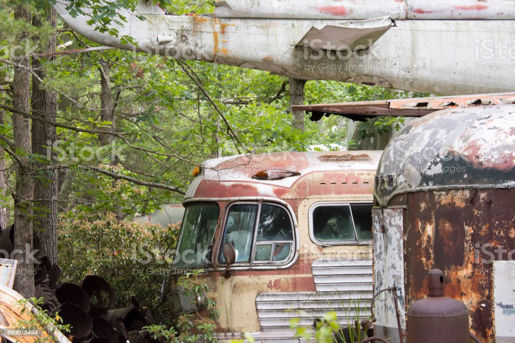 Rusting buses and planes stock photo