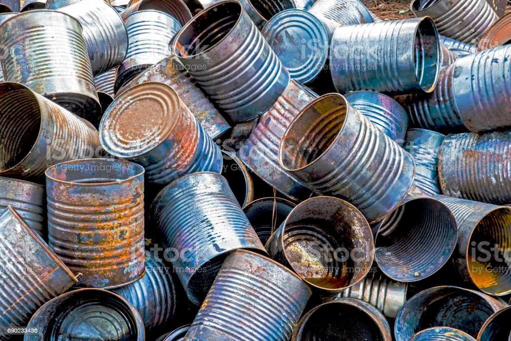 Rusting cans are piled in a pile. stock photo