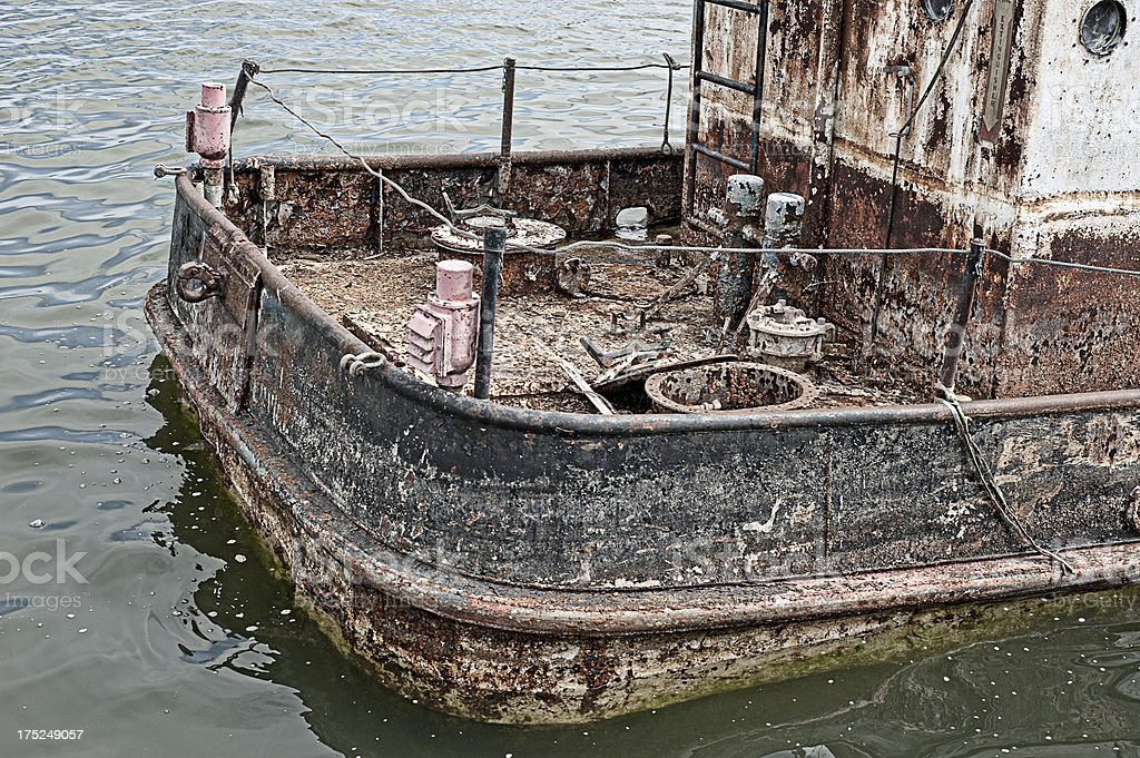 Rusting heap of was used to be a tug boat stock photo