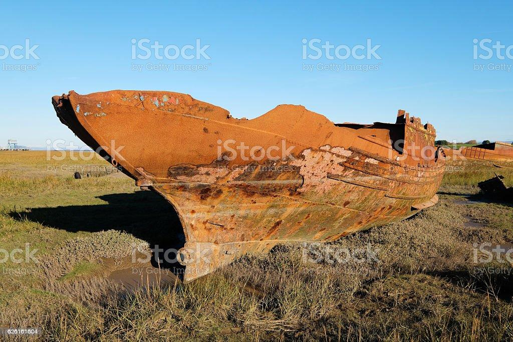 Rusting Shipwreck on Mudflats. stock photo