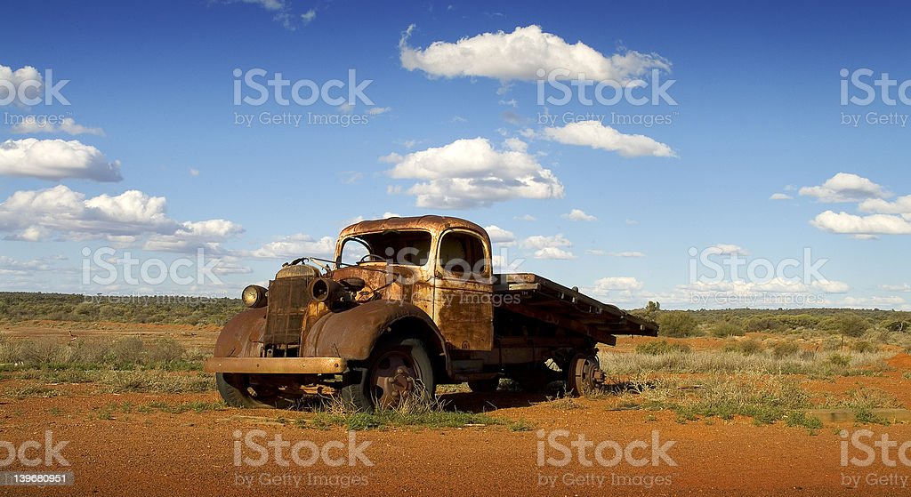 Rusty abandoned truck by the side of a road. royalty-free stock photo
