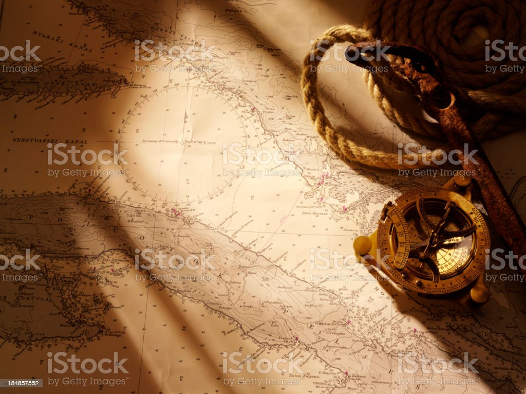Rusty Anchor and Nautical Chart stock photo