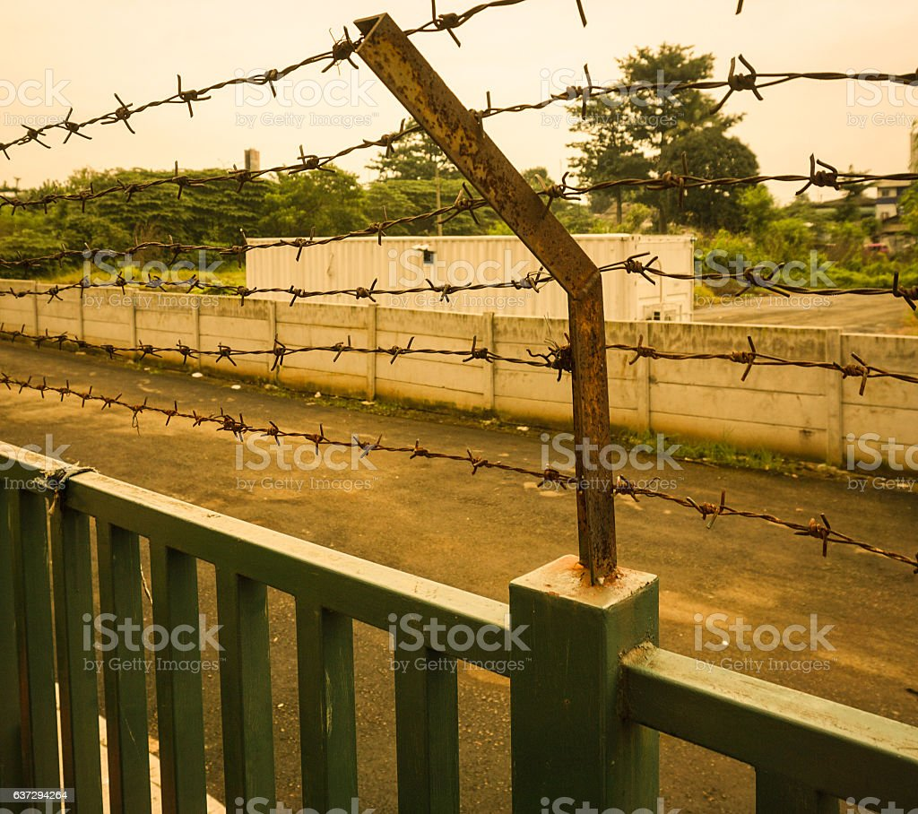 rusty barbed wire fence at Kariadi General Hospital photo taken stock photo