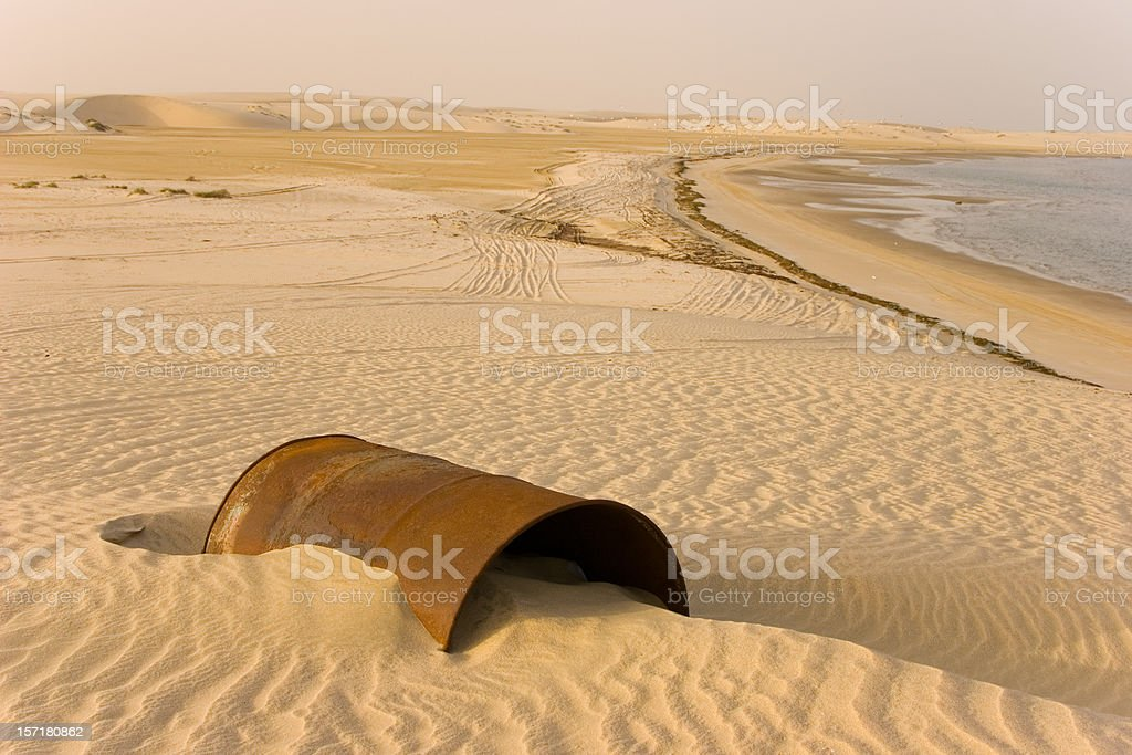 Rusty barrel in the desert stock photo