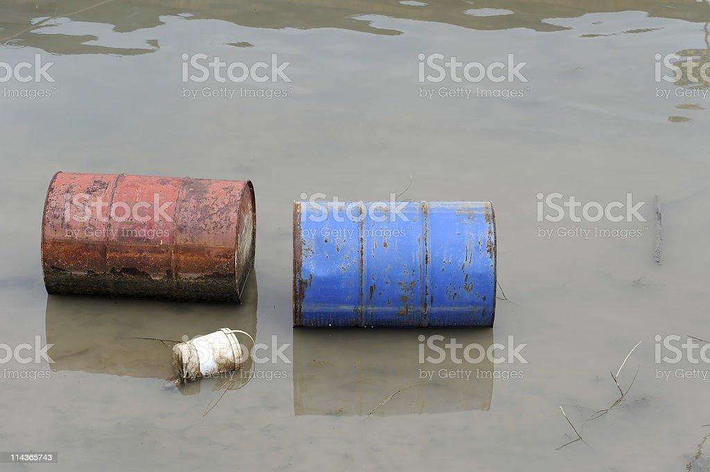 Rusty barrels in river stock photo