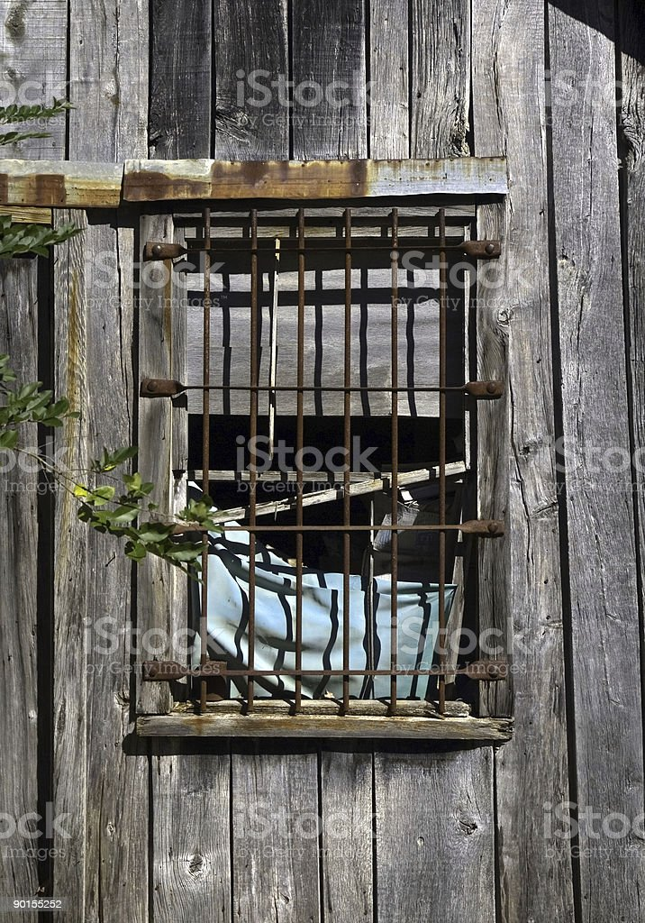 Rusty Bars on an Old Window royalty-free stock photo