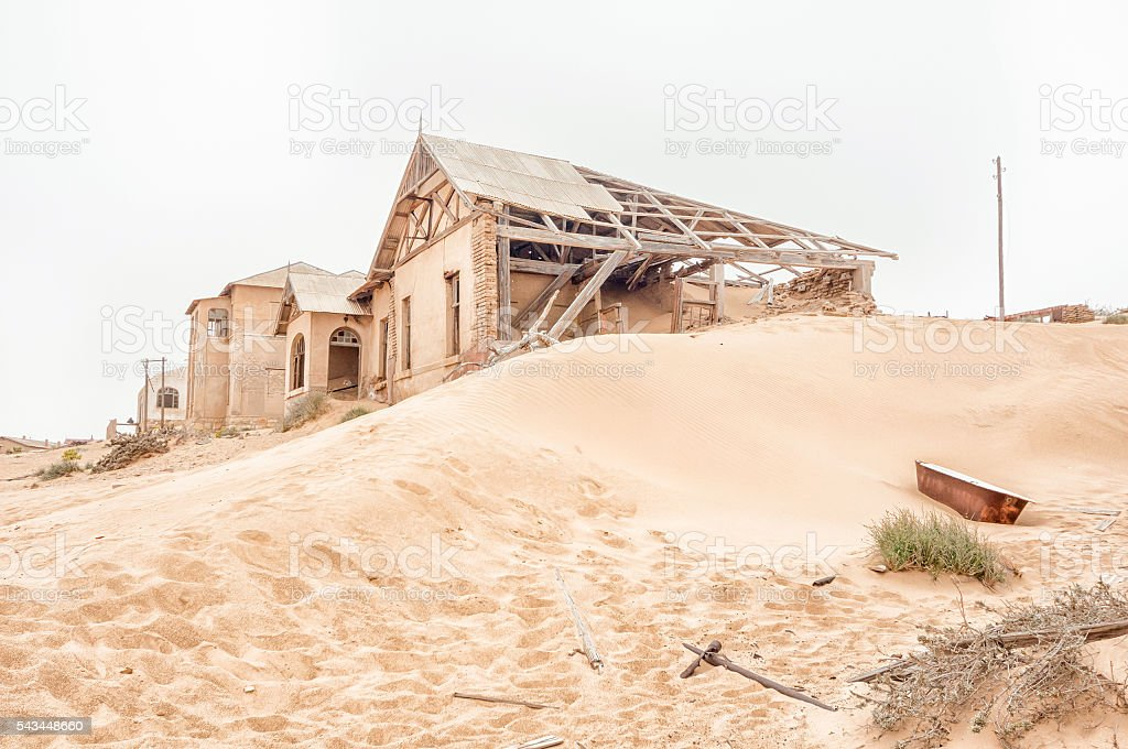 Rusty bathtub and ruins on a dune at Kolmanskop stock photo
