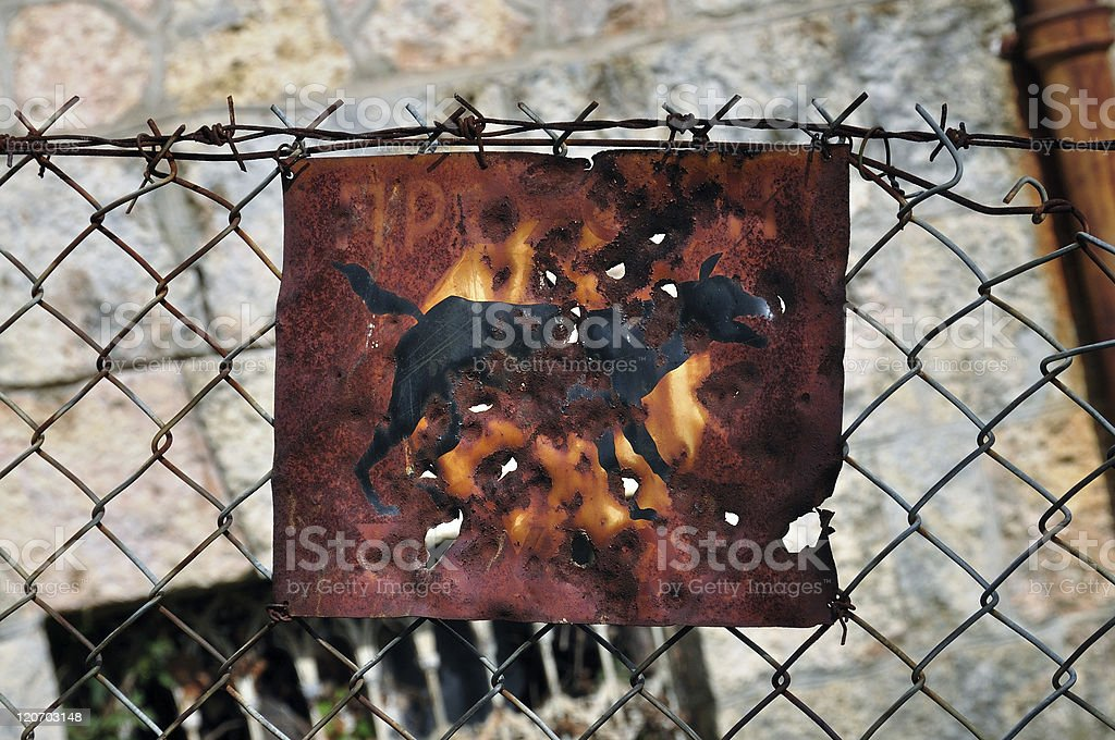 rusty beware of the dog sign royalty-free stock photo