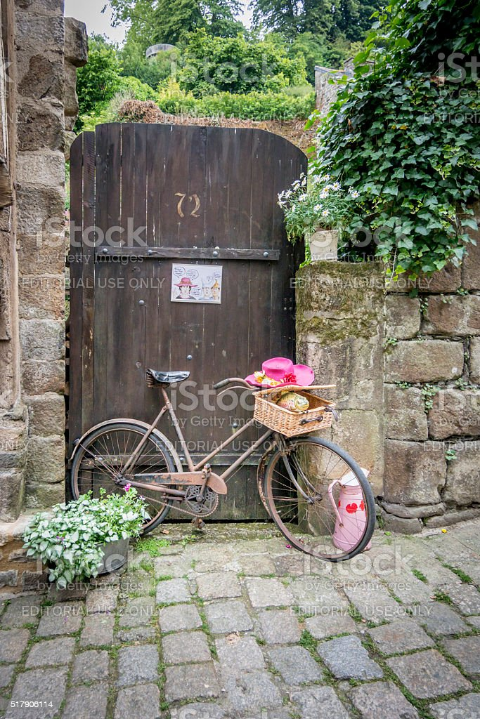 Rusty Bicycle leaning against old wooden gate stock photo