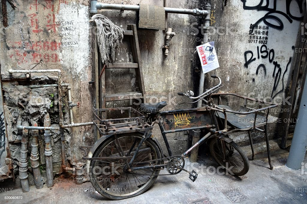 Rusty bicycle on a narrow alley in Kowloon, Hong Kong stock photo