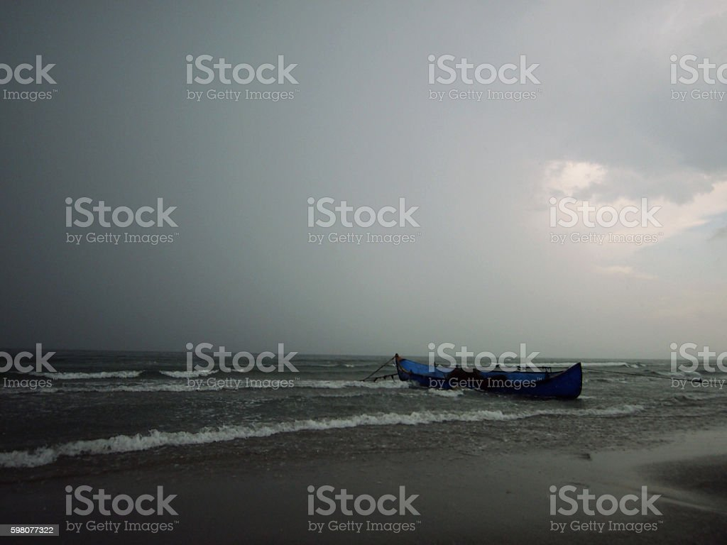 Rusty boat on a beach stock photo