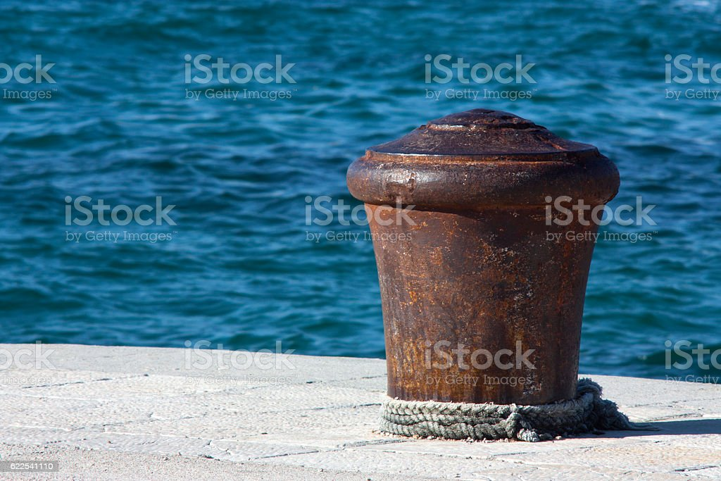 Rusty bollard stock photo