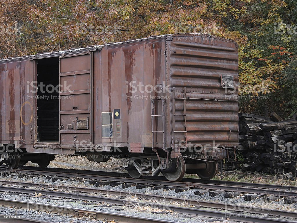 Rusty box car in the fall. royalty-free stock photo