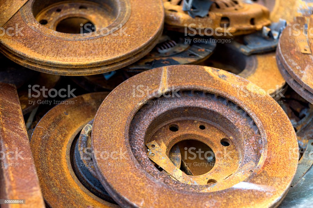 Rusty brake disc in warehouse stock photo