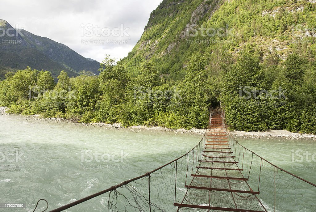 Rusty Bridge over a River royalty-free stock photo