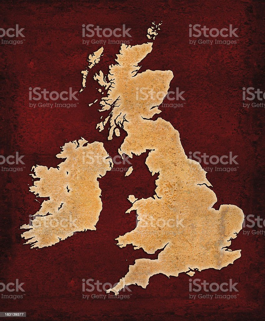 Rusty British Isles on red grunge background royalty-free stock photo