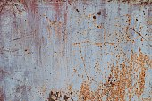 Rusty brown surface on a silver or gray plate