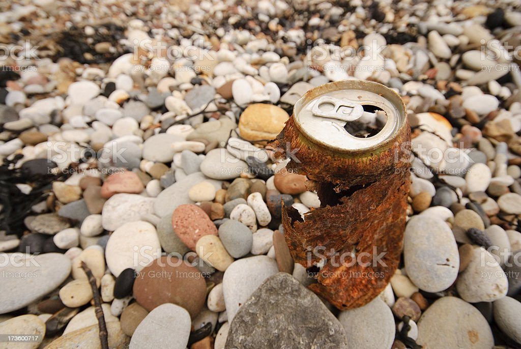 Rusty can on beach royalty-free stock photo