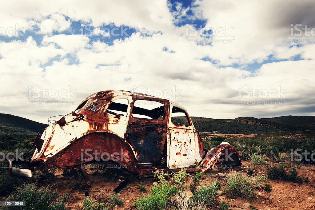 Rusty car abandoned in the middle of nowhere royalty-free stock photo