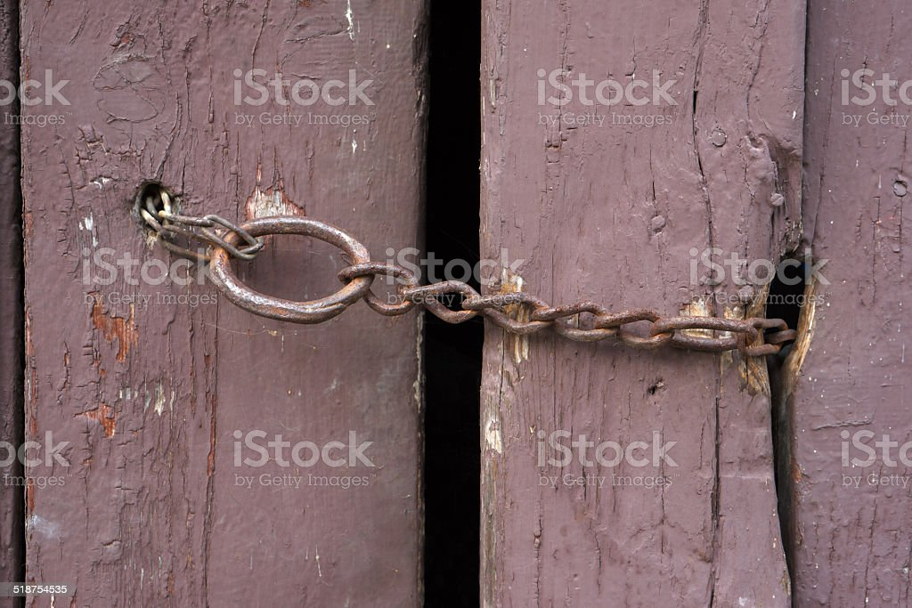 Rusty chain on an old barn door royalty-free stock photo