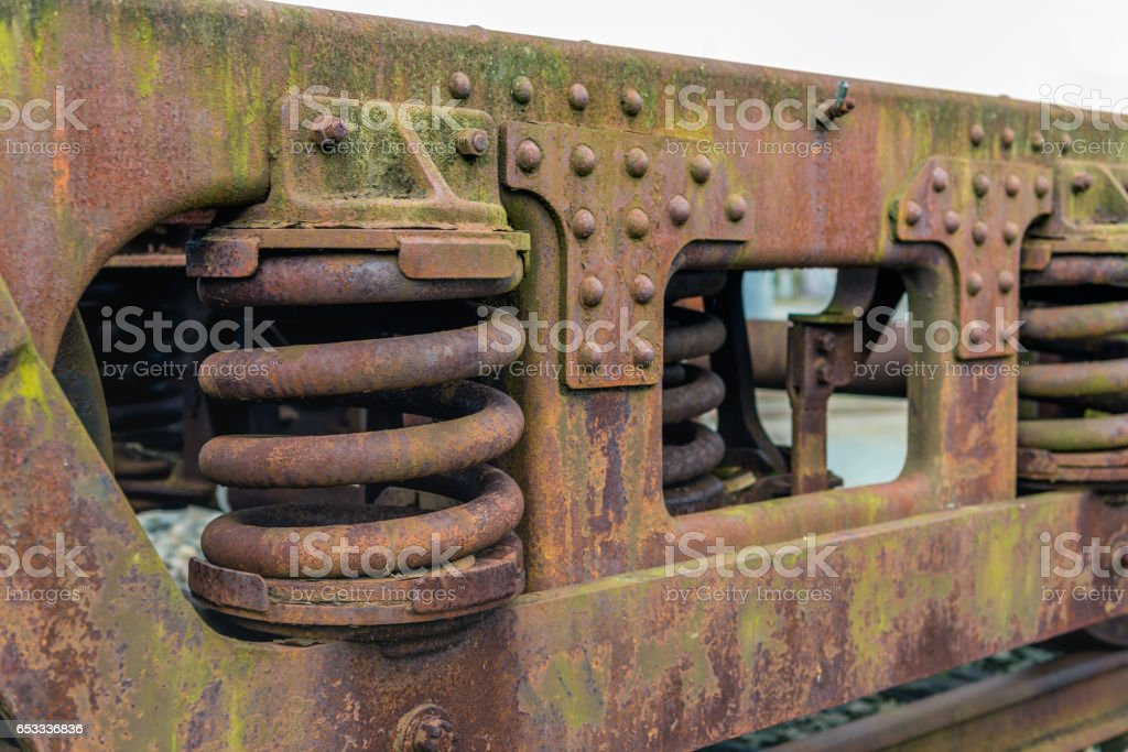 Rusty chassis of an old freight wagon stock photo