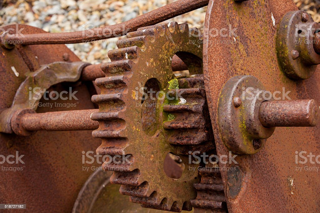 Rusty cogs on an old winch stock photo