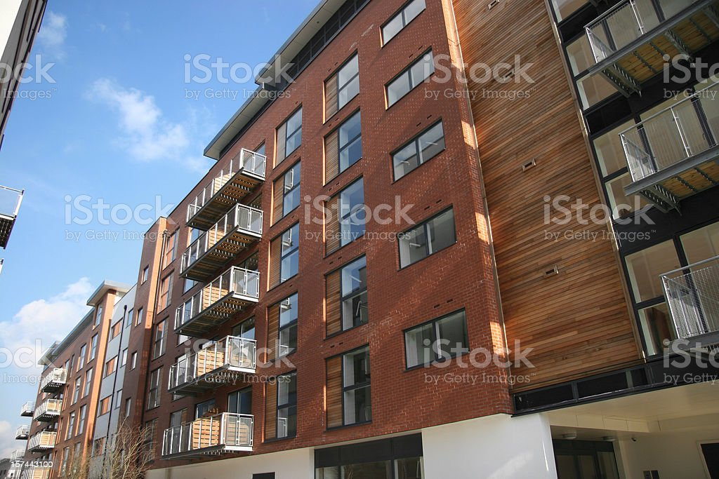 Rusty colored apartment building with wood accents royalty-free stock photo