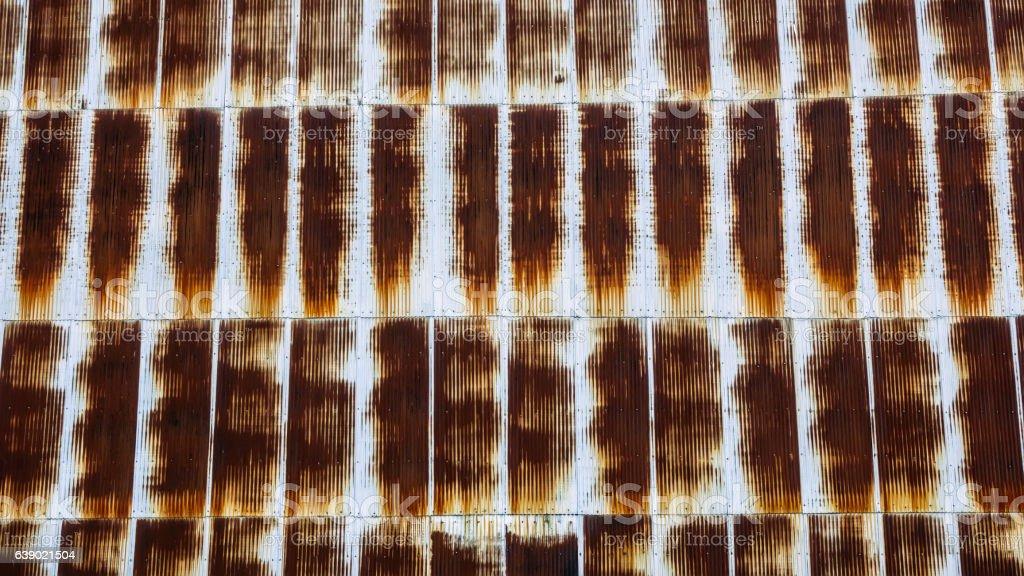 Rusty corrugated siding on old warehouse stock photo