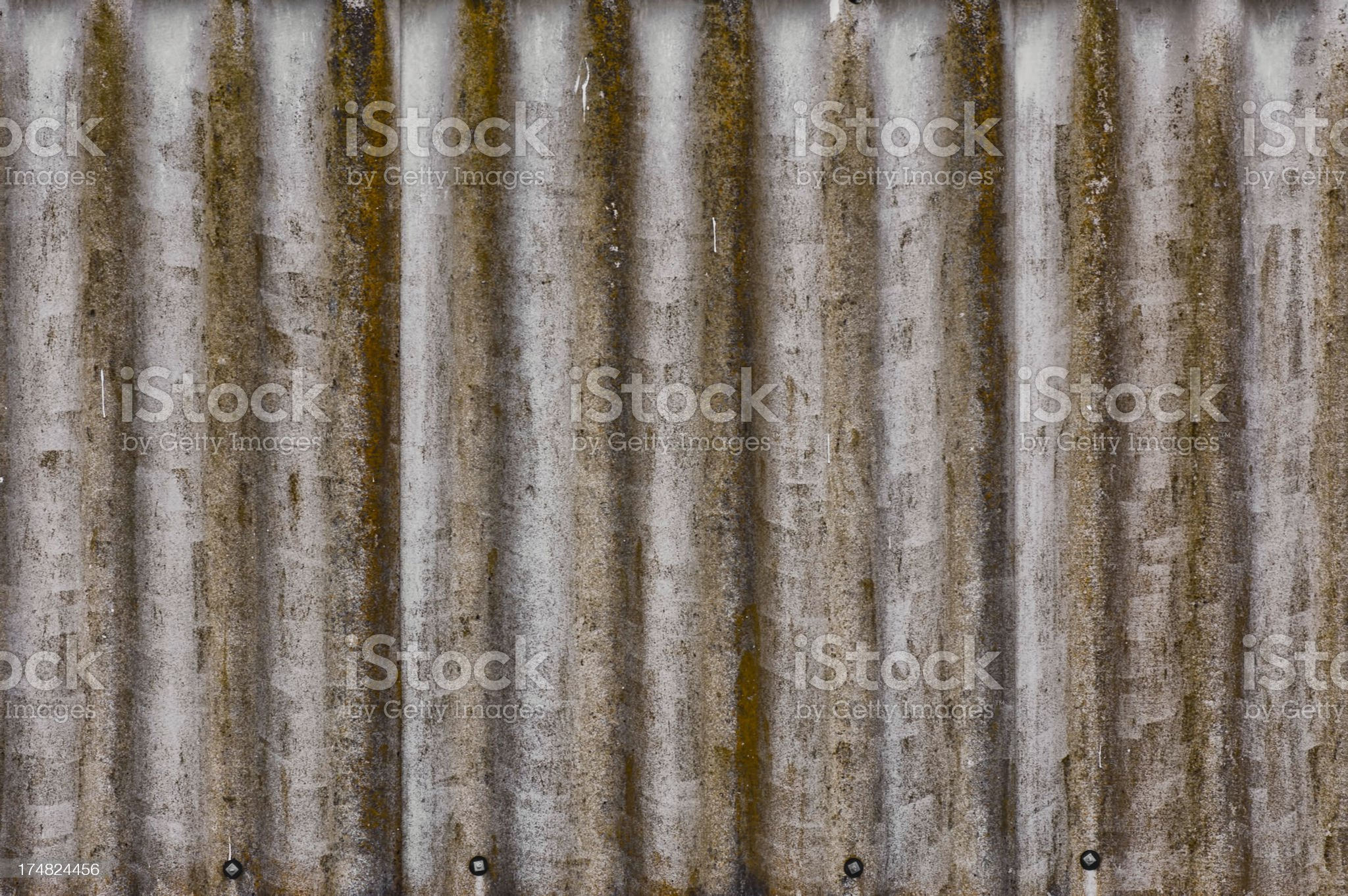 Rusty damaged corrugated metal surface texture royalty-free stock photo
