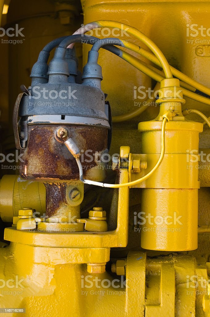 Rusty distributor with yellow coil royalty-free stock photo
