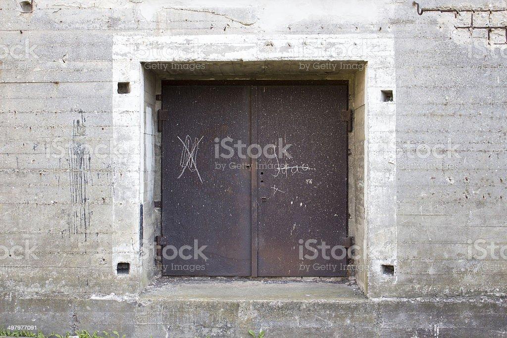 Rusty door of a bunker stock photo