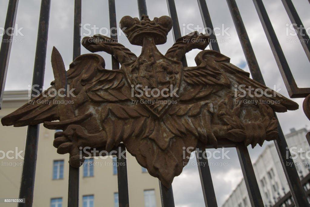 Rusty double headed eagle gate Russian empire stock photo
