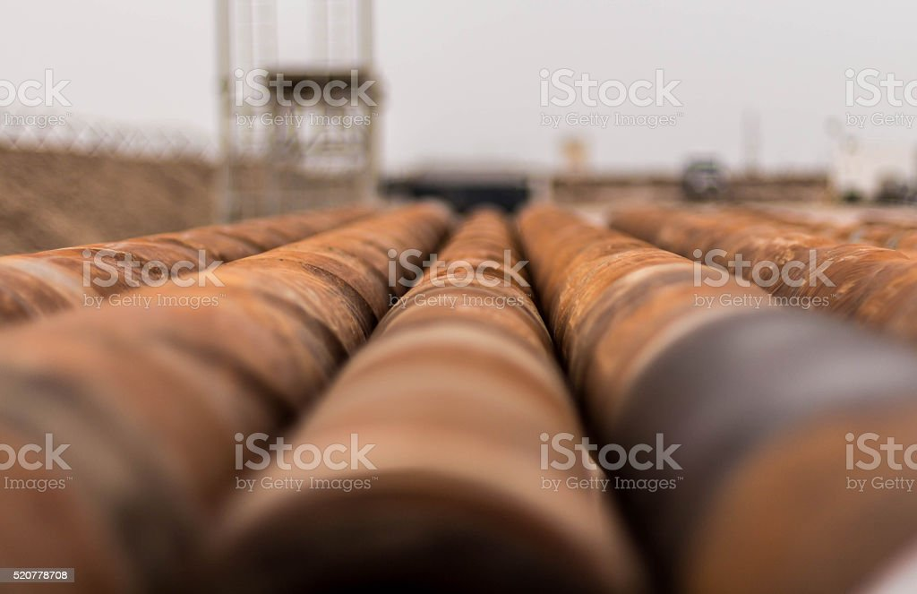 rusty drilling oil rig pipes stock photo