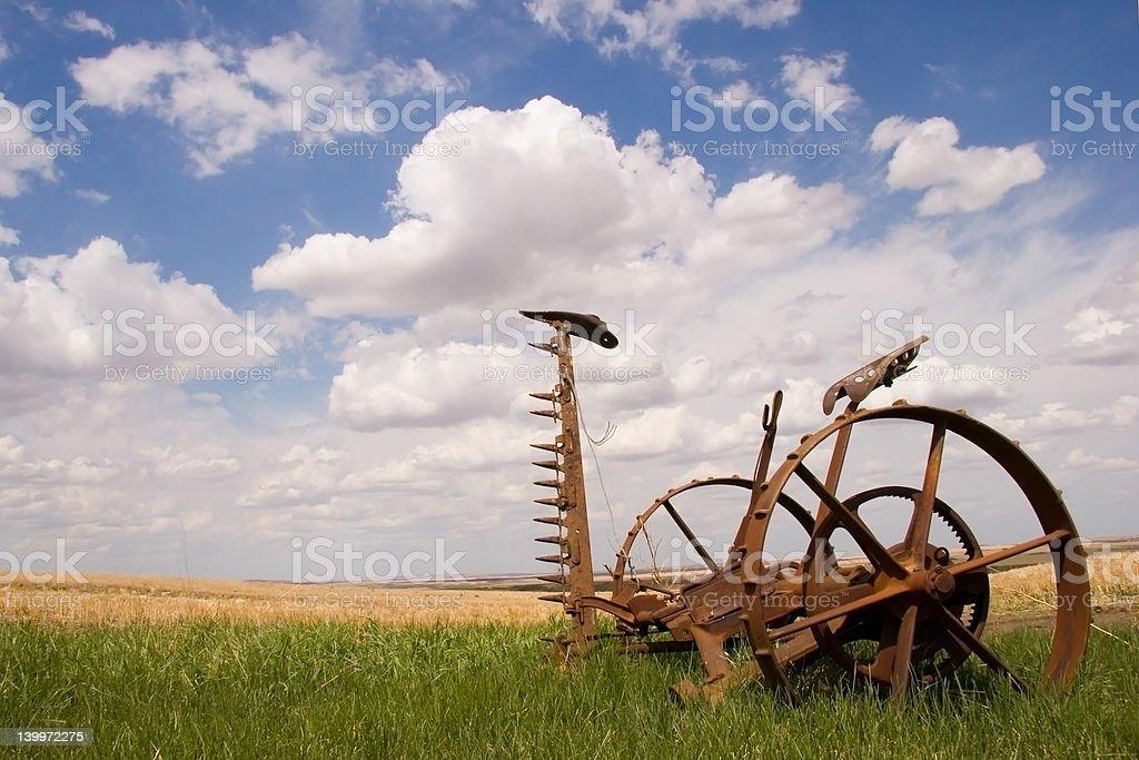Rusty farm tool in a field stock photo