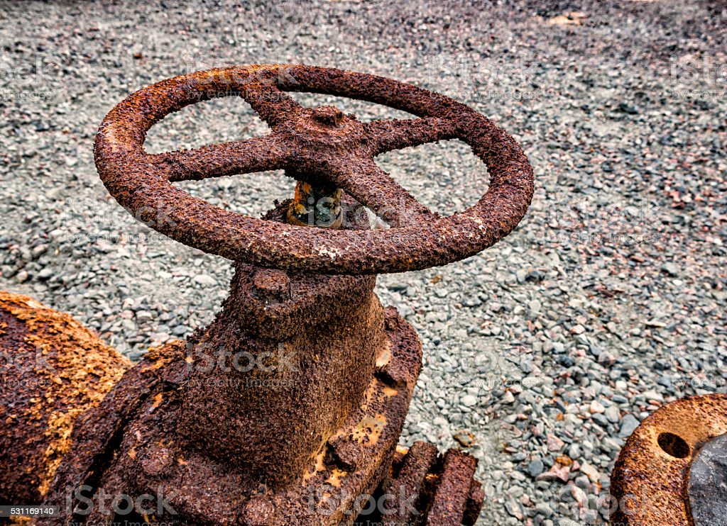 Rusty faucet from a sewer pipe stock photo