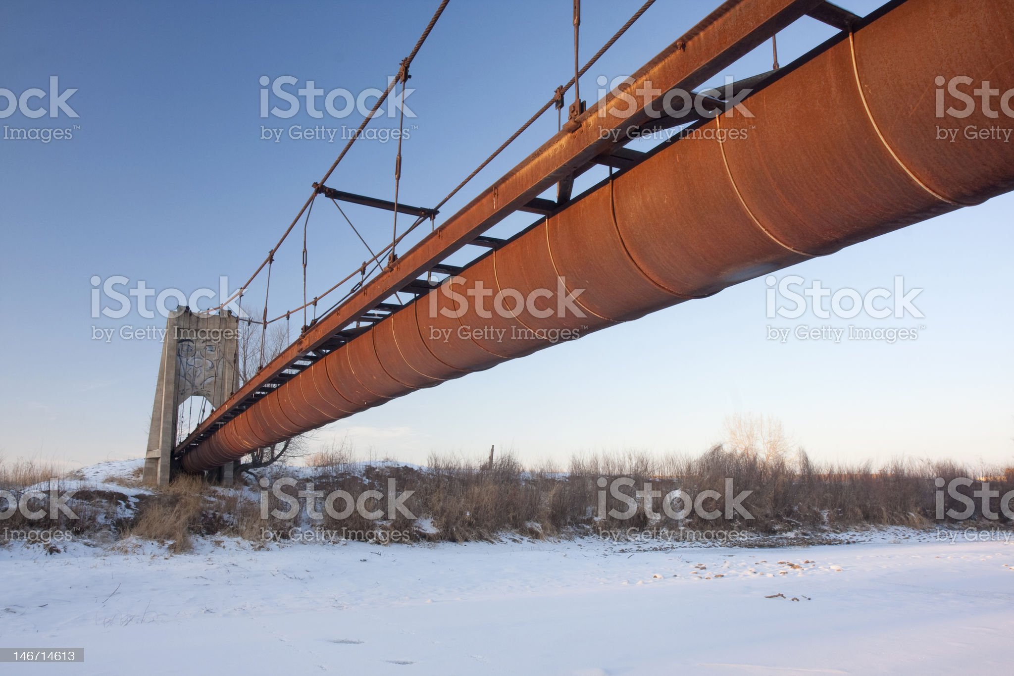 rusty flume suspended over a river royalty-free stock photo