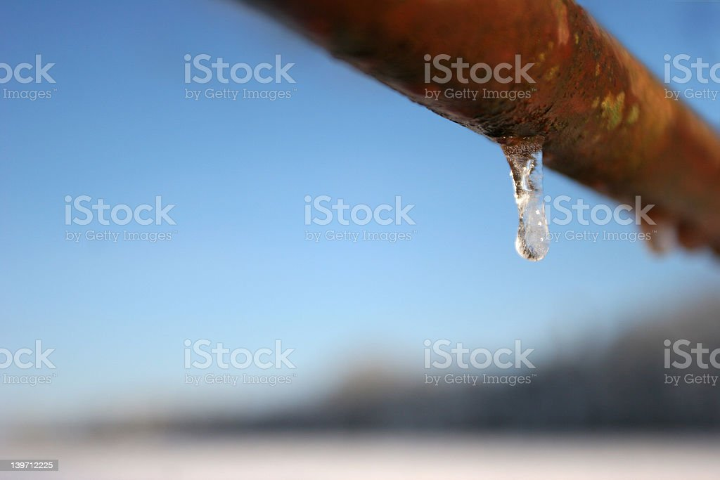 Rusty Gate in Winter with Icicle Dropping stock photo