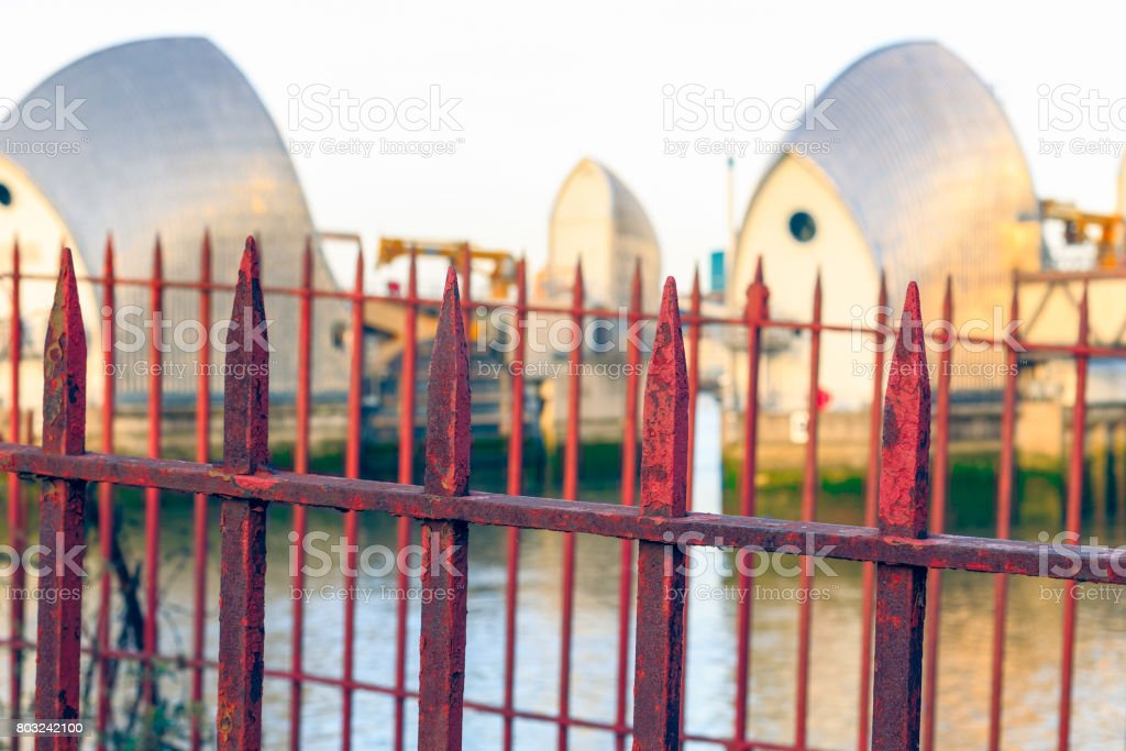 Rusty gate with Thames Barrier in the background stock photo