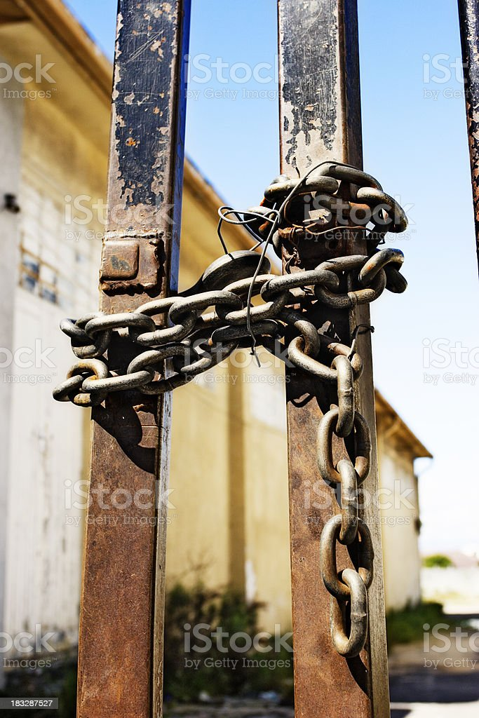 Rusty gates chained and tied with wire royalty-free stock photo