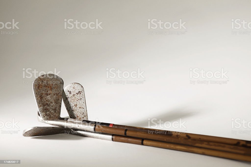 rusty golf clubs royalty-free stock photo