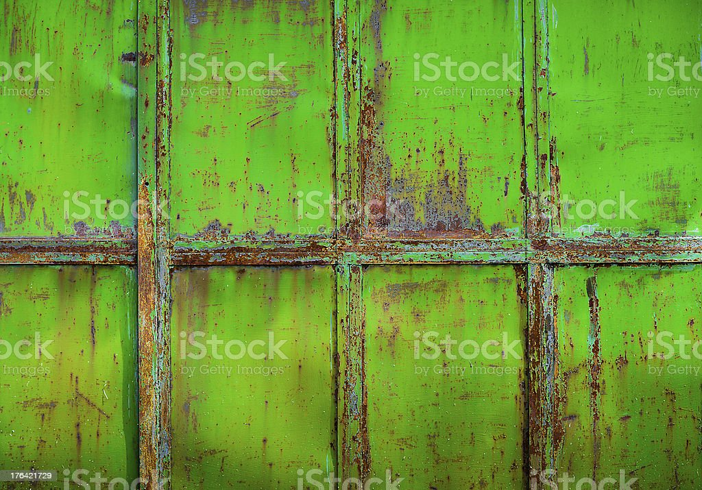 Rusty green painted metal with cracked paint, texture background royalty-free stock photo