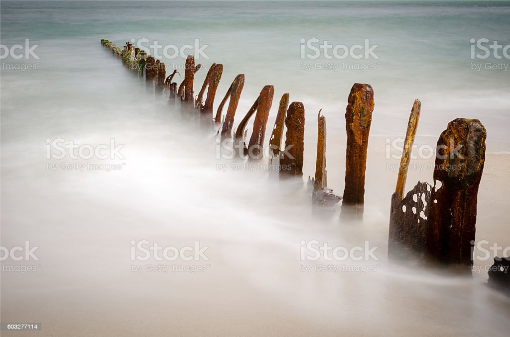 Rusty groynes on shore of the North Sea, Sylt stock photo