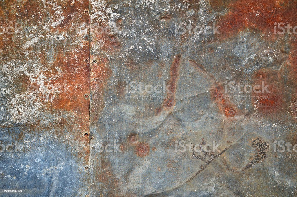 Rusty grunge old empty sheet metal wall texture background stock photo