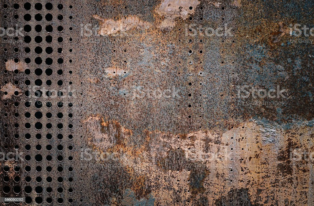 rusty grunge steel decorated by drilling a wall textured stock photo